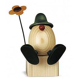 Egghead Father Anton  with flower sitting on edge, green  -  15cm / 5.9inch